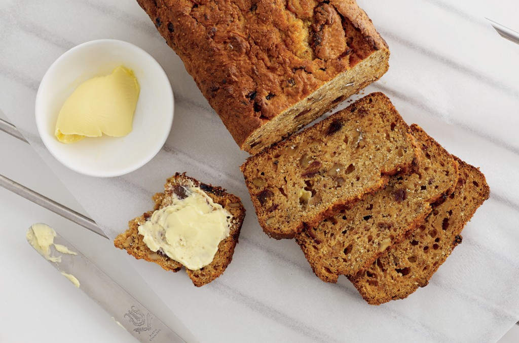 Gluten-Free Cake Loaf with three slices and some butter to serve