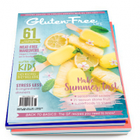 gluten-free magazine with pineapple popsicles on a blue plate