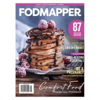 Cover of FODMAPPER issue 8 featuring a stack of fluffy gluten-free pancakes with chocolate sauce and raspberries.