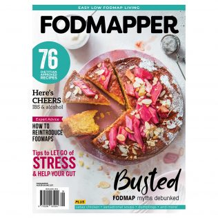 Cover of FODMAPPER magazine featuring sliced gluten-free almond and rhubarb cake with slivered almonds and icing sugar on white background.