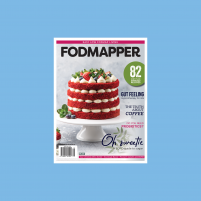 Cover of Issue 10 of FODMAPPER magazine featuring 82 dietitian approved low fodmap recipes plus low fodmap red velvet cake with berries on white cake stand.